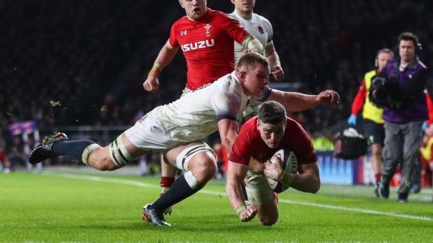 Sam Underhill stops Scott Williams from scoring during England's narrow win over Wales at Twickenham. Photograph: James Crombie/Inpho
