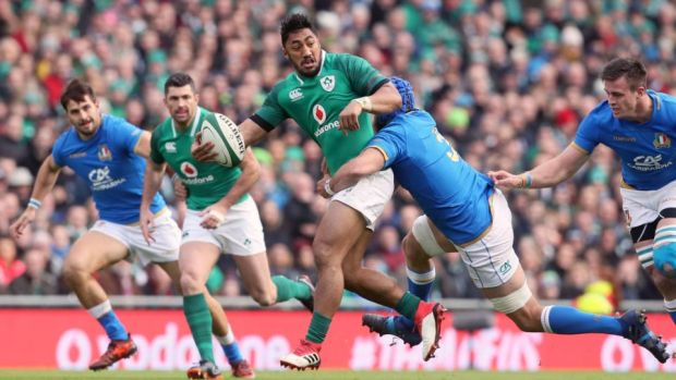 Bundee Aki offloads during Ireland's win over Italy. Photograph: Brian Lawless/PA