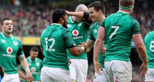 Bundee Aki and Johnathan Sexton are forming a blossoming relationship for Ireland. Photograph: Dan Sheridan/Inpho