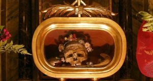 """Not satisfied with the sealed packages and bits of bone displayed elsewhere, Rome's Basilica of Santa Maria displays a skull discovered in the early 1800s which it claims to be that of St Valentine himself, wearing a crown of flowers."""