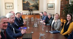 The team in Stormont, with Leo Varadkar and Theresa May in the centre. Photograph: Kelvin Boyes/Press Eye