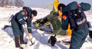 An emergency team works at the scene of the AN-148 plane crash in Stepanovskoye village. Photograph:  Russian Ministry for Emergency Situations via AP
