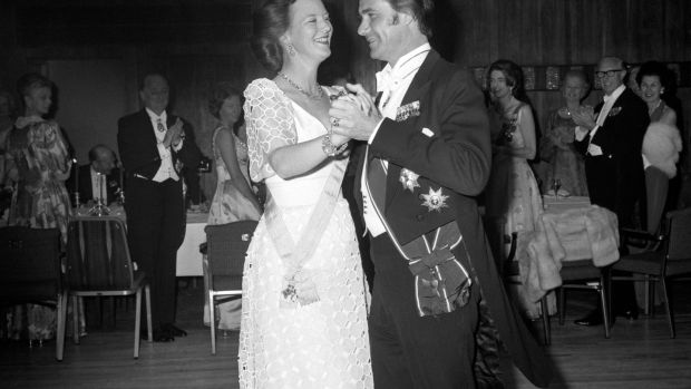 Queen Margrethe of Denmark opening the dancing with her husband, Prince Henrik of Denmark, at the Anglo-Danish Society's Jubilee dinner and dance at the Royal Garden Hotel, London in 1974. File photograph: PA