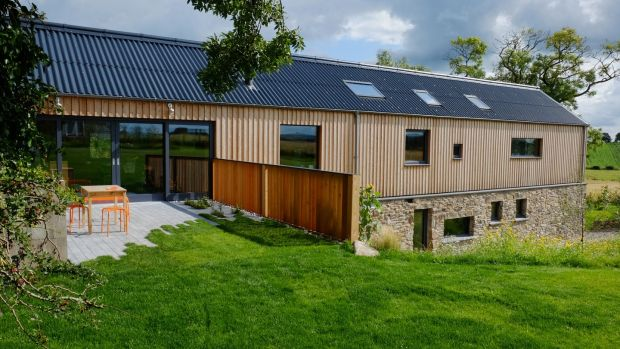 The beautiful, timber clad, open plan, agricultural-barn-inspired 'long house' is very much at home in the landscape of the gently rolling hills of Drumlins, Co Down.