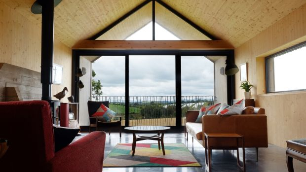The full-height living room window looks towards the Mourne mountains.