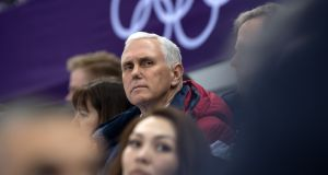 Mike Pence watches short track speed skating at Gangneung Ice Arena. Photograph: Carl Court/Getty