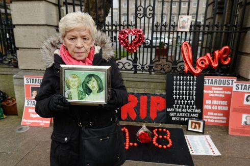 STARDUST ANNIVERSARY: Christine Keegan holding  photographs of her daughters Mary (then 19) and Martina (then 16), who died in the Stardust fire of 1981, while protesting outside the Dail on the 37th anniversary of the disaster. The incident claimed the lives of 48 people. Photograph: Alan Betson/The Irish Times