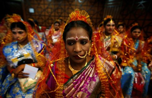 WEDDING BELLES: Brides wait to take their vows at a mass wedding ceremony organised for Valentine's Day, in Kolkata, India. Photograph: Rupak De Chowdhuri/Reuters