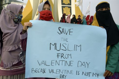 NO LOVE LOST: Indonesian Muslim students protest against Valentine's Day in Banda Aceh. The celebration of Valentine's Day has been banned in some Indonesian cities - police rounded up amorous couples, giving the official kiss-off to a tradition which critics say doesn't deserve any love in the Muslim-majority nation. Photograph: Chaideer Mahyuddin/AFP/Getty Images