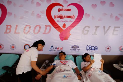 FOR THE LOVE OF BLOOD: A nurse takes blood from donors at the Blood Transfusion Center in Phnom Penh, Cambodia. Dozens of Cambodians celebrated Valentine's Day by attending an event there called Give Blood - Give Love.  Photograph: Mak Remissa/EPA