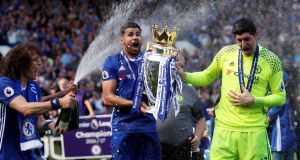 Diego Costa celebrates with the Premier League trophy last May following Chelsea's victory. File photograph: Eddie Keogh/Reuters