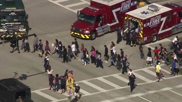 Students are evacuated from Marjory Stoneman Douglas High School during a shooting incident in Parkland, Florida. Photograph: WSVN.com via REUTERS