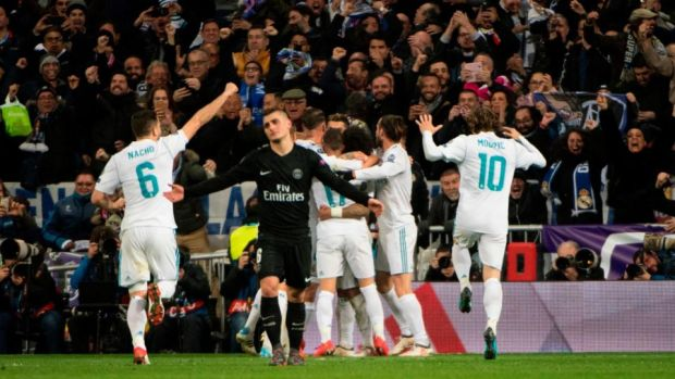 Real Madrid players after Marcelo gives them a 3-1 lead against PSG. Photograph: Curto De La Torre/AFP