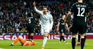 Cristiano Ronaldo celebrates his second against PSG. Photograph: Gonzalo Arroyo Moreno/Getty