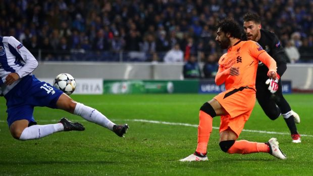 Mohamed Salah slots Liverpool's second against Porto. Photograph: Julian Finney/Getty