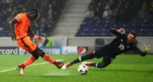 Sadio Mane scores Liverpool's third against Porto. Photograph: Julian Finney/Getty