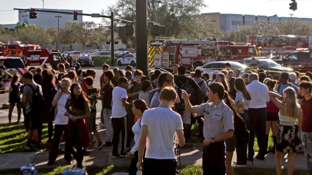 Students are released from a lockdown following a mass shooting at Marjory Stoneman Douglas High School in Parkland, Florida. Photograph: John McCall/South Florida Sun-Sentinel via AP