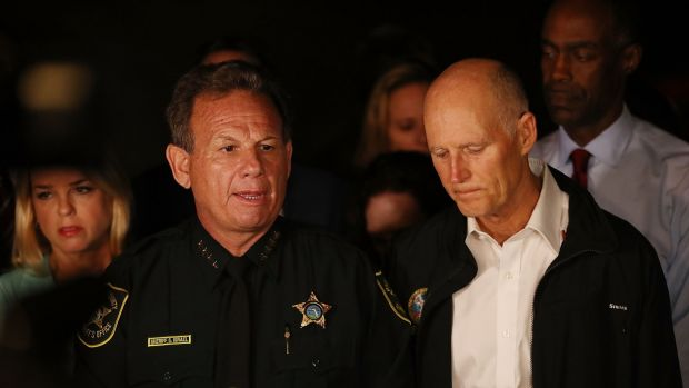 Scott Israel, Sheriff of Broward County, (L) and Flo   rida Governor Rick Scott speak to the media. Photograph: Joe Raedle/Getty Images