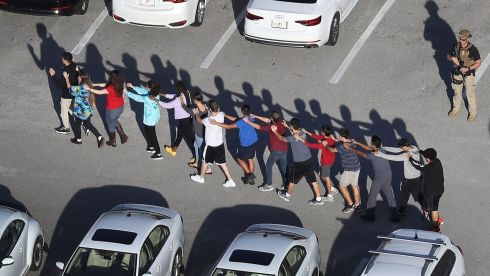 February 14th, 2018: People are brought out of the Marjory Stoneman Douglas High School in Parkland, Florida, after a shooting at the school  left 17 dead. Photograph: Joe Raedle/Getty Images