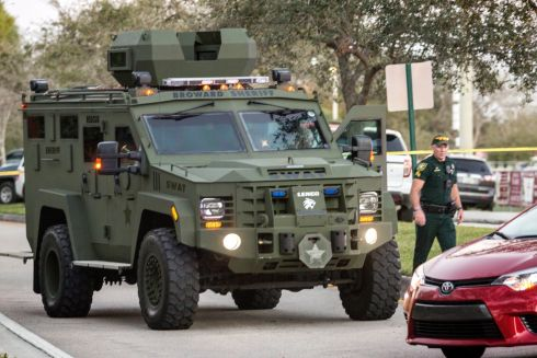 A SWAT truck stands at he side entrance of the Marjory Stoneman Douglas High School. Photograph: EPA/CRISTOBAL HERRERA