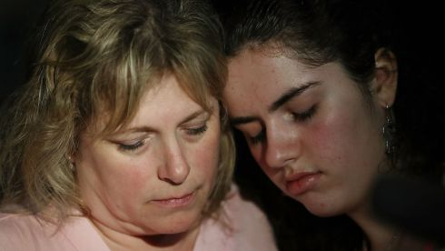 Sarah Crescitelli leans on her mother, Stacy Crescitelli (L), after she escaped the shooting. Photograph: Joe Raedle/Getty Images