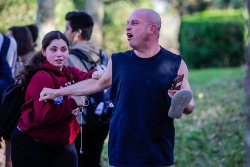 An angry father screams at police officers after the mass shooting at the Marjory Stoneman Douglas High School in Parkland, Fla., Feb. 14, 2018. At least 17 people were killed Wednesday at this school about an hour northwest of Miami, law enforcement officials said. A suspect, a former student, is in custody. (Saul Martinez/The New York Times)