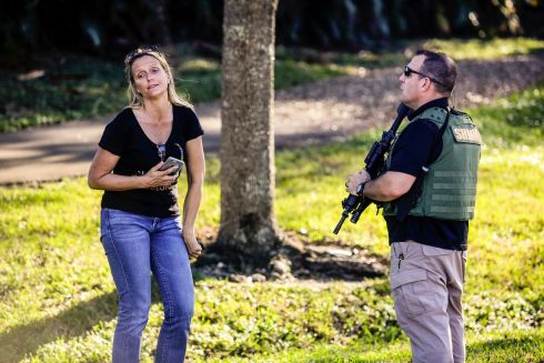 A woman reacts after speaking with a police officer after the mass shooting at the Marjory Stoneman Douglas High School in Parkland, Fla., Feb. 14, 2018. At least 17 people were killed Wednesday at this school about an hour northwest of Miami, law enforcement officials said. A suspect, a former student, is in custody. (Saul Martinez/The New York Times)