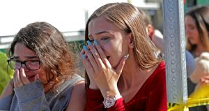 Students released from a lockdown are overcome with emotion following following the shooting at Marjory Stoneman Douglas High School in Florida. Photograph: AP