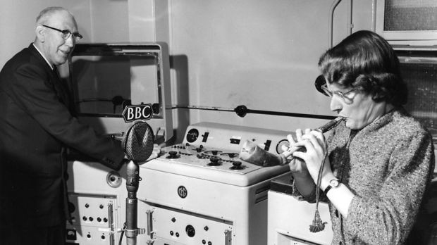 Daphne Oram is blowing a Mijwiz, an Arabic reed pipe, while Richard Bird records the sound on a tape machine. Richard, known as Dickie, was the BBC Radiophonic Workshop's first engineer. Photograph: BBC