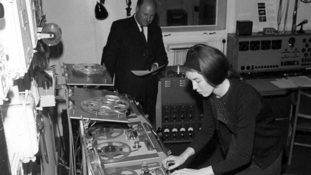 Delia Derbyshire editing a musical note on tape, with help from Desmond Briscoe. Derbyshire, a pioneer of electronic music, produced the soundtrack and theme music for the TV series 'Dr Who'. Photograph: BBC