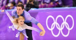 Ice cool: Germany's Aljona Savchenko and Germany's Bruno Massot win gold in the pairs figure skating event in Pyeongchang on Thursday. Photograph:  AFP
