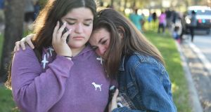 Students react following a shooting at Marjory Stoneman Douglas High School in Parkland, Florida, a city about 80 kilometers north of Miami, on Wednesday. Photograph: Michele Eve Sandberg/AFP/Getty Images