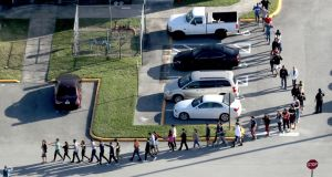 Students are evacuated by police from Marjory Stoneman Douglas High School in Parkland, Floridaa on Wednesday after a shooter opened fire on the campus, killing 17 people. Photograph: Mike Stocker/South Florida Sun-Sentinel via AP.