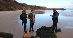 Robin Gill (centre), with Geraldine Kavanagh of Wild Wicklow foods and Luke Matthews, on  Magheramore beach in Wicklow.