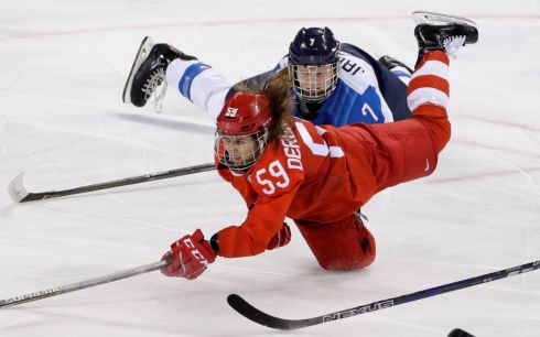 WINTER OLYMPICS: Russia's Yelena Dergachyova falls to the ice with Mira Jalosuo of Finland during their ice hockey match at the Kwandong Hockey Centre. Photograph: David W Cerny/Reuters
