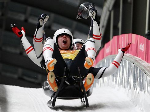 WINTER OLYMPICS: Peter Penz and Georg Fischler of Austria celebrate after the luge team relay in Pyeongchang. Photograph: Edgar Su/Reuters