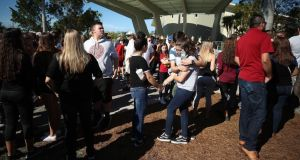 Students from Marjory Stoneman Douglas High School gather at Pine Trail Park in Parkland, Florida, on Thursday. Photograph: Mark Wilson/Getty Images