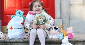 Serene (4) with Bootsy. She came to Ireland from Syria  as a baby. Photograph: Irish Red Cross