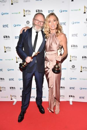 Liam Cunningham who won best supporting in a drama  Games of Thrones and Victoria Smurfit who won best supporting actress in a film for The Lears. Photograph: Michael Chester