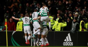 Celtic players celebrate with Callum McGregor after his goal. Photograph: Reuters