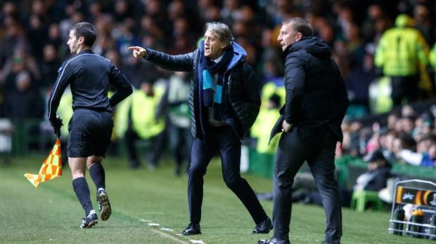 Roberto Mancini of FC Zenit and Brendan Rodgers give instructions from the sideline at Celtic Park. Photograph: PA
