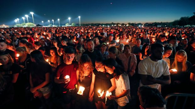 People attend a candlelight vigil at Marjory Stoneman Douglas High School, Florida. Photograph: Gerald Herbert/AP