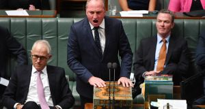 Australia's prime minister Malcolm Turnbull (left) listens as deputy prime minister Barnaby Joyce speaks in parliament on Wednesday this week. Photograph: Mick Tsikas/ EPA
