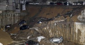 A large sinkhole opened in a street of a residential area in Rome this week. Photograph: Massimo Percossi/ANSA via AP