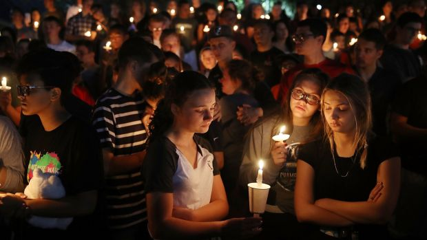 A candlelight vigil for victims of the shooting was held in Parkland on Thursday. Photograph: Joe Raedle/Getty Images