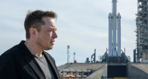 Elon Musk, founder of SpaceX, with the company's Falcon Heavy rocket: the firm  will on Saturday officially enter the race to bring internet access to all parts of the earth's surface with the planned launch of its first test satellites for a globe-encompassing communications network