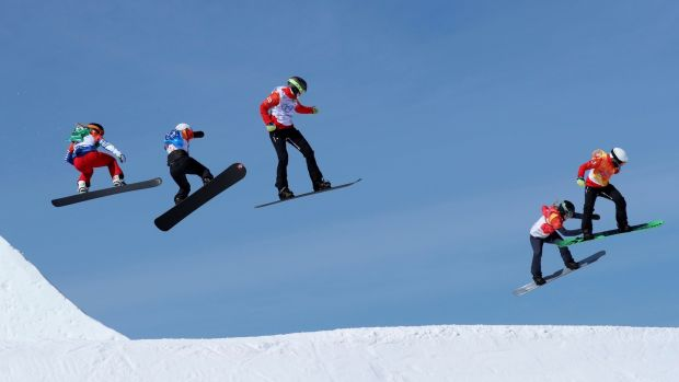 Action from the women's snowboard cross. Photograph: Mike Blake/Reuters