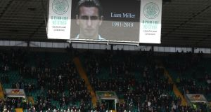 Celtic fans stand for a minute's silence in memory of Liam Miller at Parkhead. Photograph: Andrew Milligan/PA