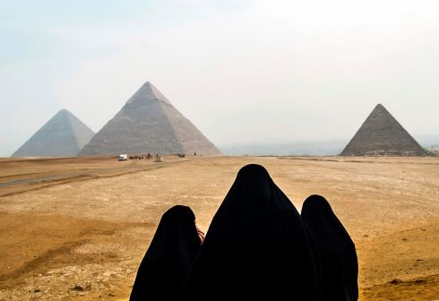 Veiled Egyptian women gaze upon the Great Pyramids of Giza. Photograph: Daj;ed Desouki/AFP/Getty Images