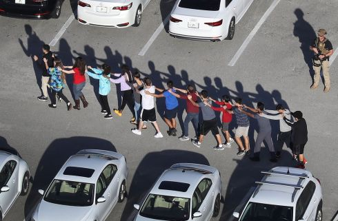 People are brought out of the Marjory Stoneman Douglas High School in Florida after a shooting that left 17 dead. Photograph: Joe Raedle/Getty Images
